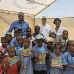 Cabo Verde H.S.H. Prince Albert II with Mr Jose Luis Santos, Mayor of Boa Vista and Mrs Sónia Araujo, representative of the Cabo Verde Government, coordinator of the national marine turtle conservation programme, hands over the booklet on marine turtles to schoolchildren participating in a coastal trip. Image credit ©Olivier Borde Monaco Explorations.